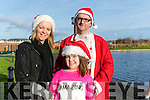 Martin, Georgina and Megan O'Sullivan, pictured at the Santa Fun Run, in aid of Barretstown, starting from the Tralee Bay Wetlands, on Sunday last.