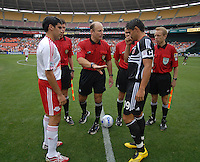New York Red Bulls Claudio Reyna (10) and DC United forward Jaime Moreno (99) during the coin toss with referee Brian Hall. DC United defeated the New York Red Bulls, 4-2, at RFK Stadium in Washington DC, Sunday, June 10, 2007.