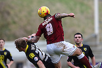 Marc Richards of Northampton Town (right) beats Andy Parrish of Morecambe (left) in an aerial battle during the Sky Bet League 2 match between Northampton Town and Morecambe at Sixfields Stadium, Northampton, England on 23 January 2016. Photo by David Horn / PRiME Media Images.