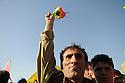 Irak 2009. A PKK fighter raises his hand to wave to the crowd before crossing the border to Turkey .Irak 2009 .Un combattant du PKK salue la foule de ses sympathisants avant de franchir la frontiere pour la Turquie..