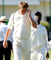 Brad Sculley of North Middx feels the heat during the Middlesex County Cricket League Division Two game between North Middlesex and Enfield at Park Road, Crouch End, London on Sat May 22, 2010