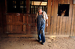 Jim takes a moment to rest after feeding all five horses in a friends barn. Jim and Charlene always are helping out others.