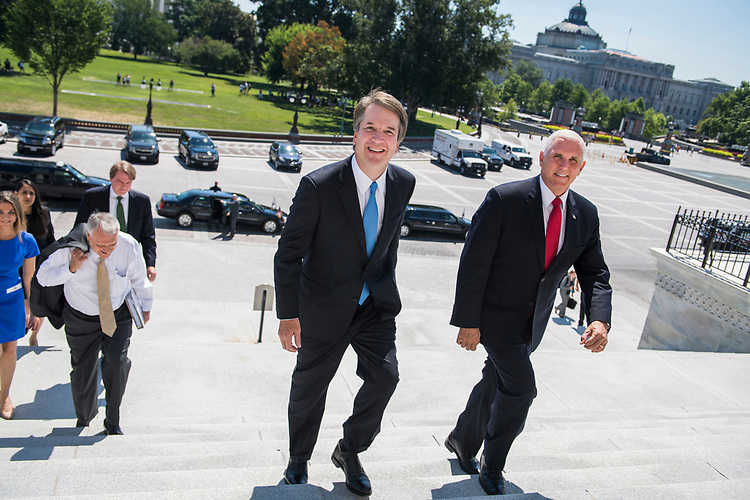 UNITED STATES - JULY 10: Supreme Court nominee Brett Kavanaugh, center, walks up the Capitol's Senate steps with Vice President Mike Pence for a meeting with Senate Majority Leader Mitch McConnell, R-Ky., on July 10, 2018. (Photo By Tom Williams/CQ Roll Call)