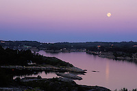 Moonset over Vasskalven Island, Norway.<br /> <br /> This image was taken around 4:30 one summer morning, just before the sun rose behind me.