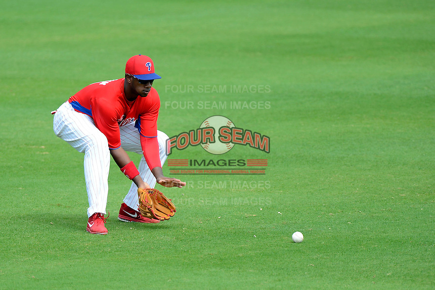 Philadelphia Phillies outfielder Domonic Brown #9 fields a base hit during a Spring Training game against the New York Yankees at Bright House Field on February 26, 2013 in Clearwater, Florida.  Philadelphia defeated New York 4-3.  (Mike Janes/Four Seam Images)
