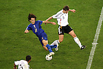 04 July 2006: Andrea Pirlo (ITA) (21) has his back foot clipped by Sebastian Kehl (GER) (5) as Pirlo tries to cut the ball back. Italy defeated Germany 2-0 in overtime at Signal Iduna Park, better known as Westfalenstadion, in Dortmund, Germany in match 61, the first semifinal game, in the 2006 FIFA World Cup.