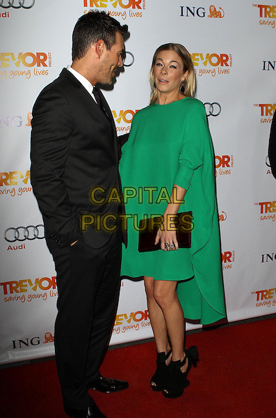 Eddie Cibrian and LeAnn Rimes.Trevor Live at The Hollywood Palladium in Hollywood, California, USA..December 4th, 2011.full length dress green clutch bag side black suit stubble facial hair couple shoes profile funny.CAP/ADM/KB.©Kevan Brooks/AdMedia/Capital Pictures.