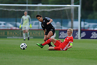 Sarah Gregorius of New Zealand Women's is tackled by Sophie Ingle of Wales Women's' during the Women's International Friendly match between Wales and New Zealand at the Cardiff International Sports Stadium in Cardiff, Wales, UK. Tuesday 04 June, 2019
