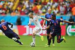 (L to R) <br /> Andres Iniesta (ESP), <br /> Jonathan de Guzman (NED), <br /> JUNE 13, 2014 - Football /Soccer : <br /> 2014 FIFA World Cup Brazil <br /> Group Match -Group B- <br /> between Spain 1-5 Netherlands <br /> at Arena Fonte Nova, Salvador, Brazil. <br /> (Photo by YUTAKA/AFLO SPORT) [1040]