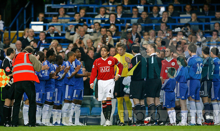 Chelsea players form a guard of honour as the Manchester United players come out onto the pitch.