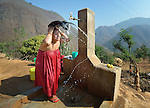 A woman washes her hair in Salang, a village in the Dhading District of Nepal where Dan Church Aid, a member of the ACT Alliance, has provided a variety of support to local villagers in the wake of a devastating 2015 earthquake. The village's water system was destroyed by the quake, forcing women to walk two hours or more to a nearby river to fetch water. Working with a local organization, the Forum for Awareness and Youth Activity, the ACT Alliance rebuilt the village's water system.