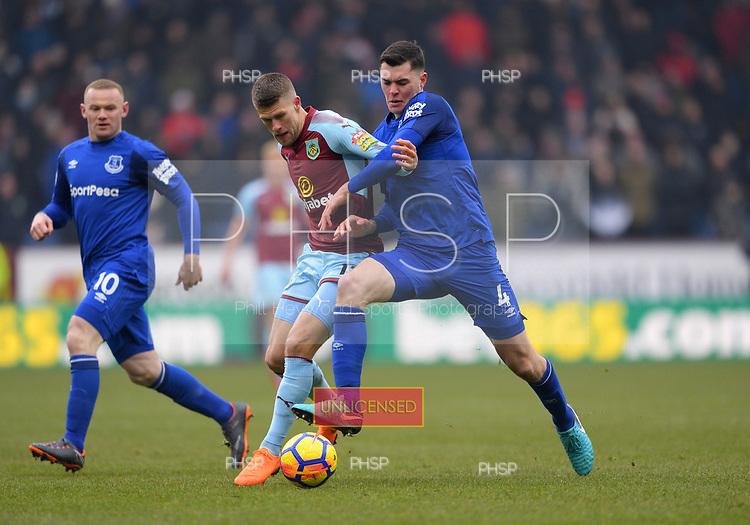 03/03/2018 Premier League Burnley v Everton<br /> <br /> Johann Berg Gudmundsson battles with Michael Keane
