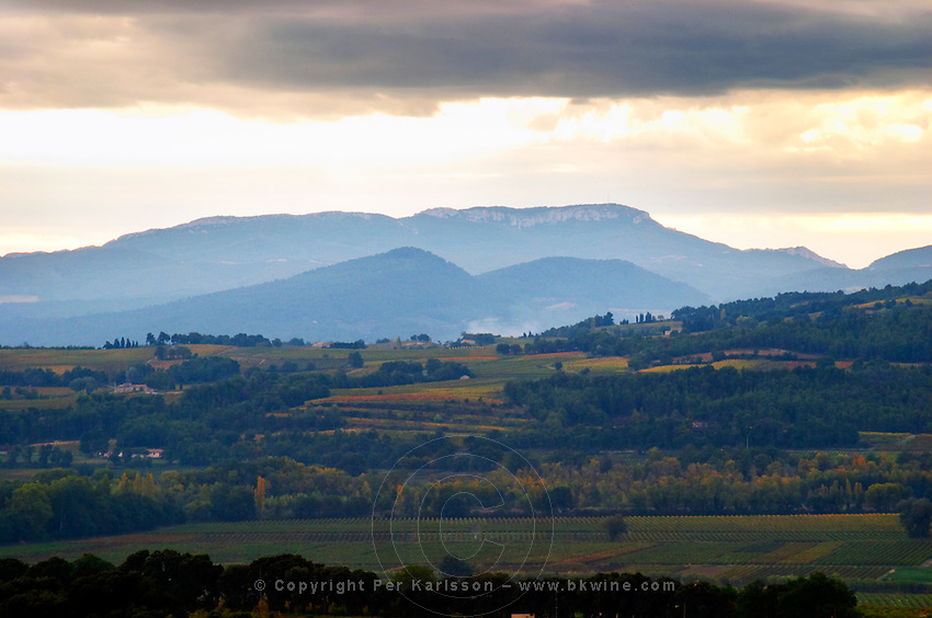 The Dentelles de Montmirail mountain range from the north under storm clouds. Vaucluse, France, Europe