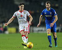 January transfer target George Williams of MK Dons passes the ball under pressure from Jonathan Meades of AFC Wimbledon during the Sky Bet League 1 match between MK Dons and AFC Wimbledon at stadium:mk, Milton Keynes, England on 13 January 2018. Photo by David Horn.