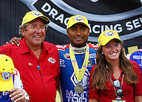 Apr 27, 2014; Baytown, TX, USA; NHRA top fuel dragster driver Antron Brown celebrates with team owner Don Schumacher and daughter Megan Schumacher after winning the Spring Nationals at Royal Purple Raceway. Mandatory Credit: Mark J. Rebilas-
