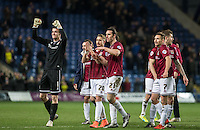 The Northampton Town players celebrate there victory during the Sky Bet League 2 match between Oxford United and Northampton Town at the Kassam Stadium, Oxford, England on 16 February 2016. Photo by Andy Rowland.