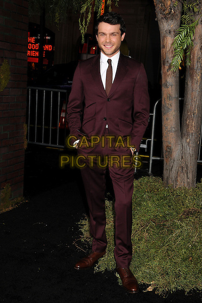 "Alden Ehrenreich.""Beautiful Creatures"" Los Angeles Premiere held at the TCL Chinese Theatre, Hollywood, California, USA. .February 6th, 2013.full length suit hands in pockets white shirt maroon burgundy purple .CAP/ADM/BP.©Byron Purvis/AdMedia/Capital Pictures."