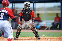 GCL Astros catcher Randy Vasquez (61) waits for a throw as Carter Kieboom (9) heads home during a game against the GCL Nationals on August 14, 2016 at the Carl Barger Baseball Complex in Viera, Florida.  GCL Nationals defeated GCL Astros 8-6.  (Mike Janes/Four Seam Images)