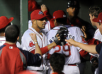 LHP Franklin Morales (56) of the Boston Red Sox, is congratulated after pitching in a rehab assignment with the Greenville Drive in a game against the West Virginia Power on Wednesday, April 17, 2013, at Fluor Field at the West End in Greenville, South Carolina. Morales pitched three scoreless innings, giving up one hit. He is working back from a shoulder injury. (Tom Priddy/Four Seam Images)
