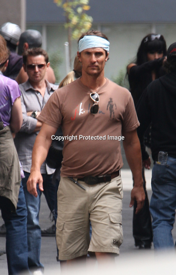 Septemeber 22nd 2010 Exclusive.Matthew McConaughey in disguise just like Mel Gibson..PICKING HIS NOSE..Matthew was directing a country music video for the singer Jamey Johnson. Matthew was also acting in the video wearing a weird Halloween Batman looking mask. In one scene Matthew pulls the pants off a muscle bound bodybuilder. The huge muscle man was wearing a rainbow colored speedo & Matthew was wearing his signature J.K Livin. t-shirt.. Matthew covered the bottom half of his face with a blue Do-Rag so the public wouldn't recognize him. Matthew was running down Hollywood Blvd being chased by a drunk Monkey Ape Gorilla. It looks likes Matthew was sporting a little bit of a beer belly. In another scene three skanky blonde girls poked fun of the drunk Gorilla who was drinking alcohol on Hollywood Blvd. ..AbilityFilms@yahoo.com.805-427-3519.www.AbilityFilms.com..