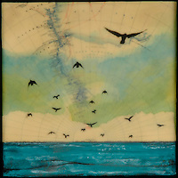 Encaustic painting over antique map of Antarctica with photo transfer of birds flying over the ocean