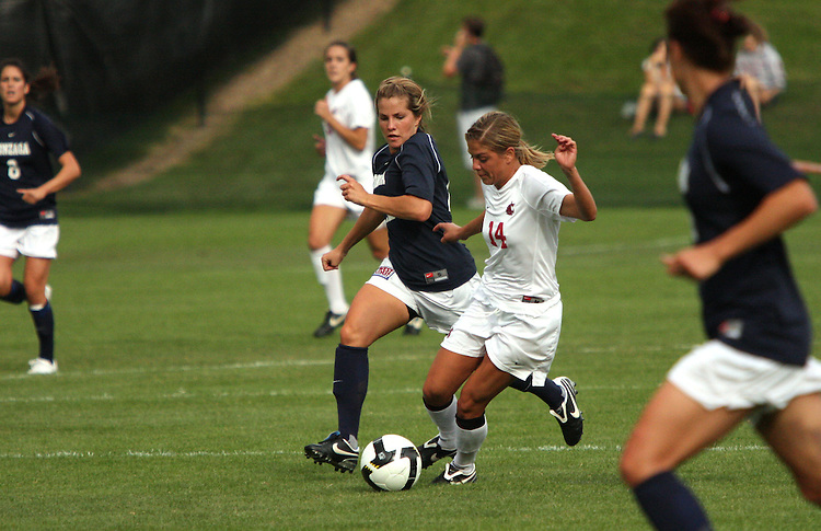 Caeli Abeyta (#14), Washington State junior midfielder, dribbles the ball downfield during the Cougars match with the Gonzaga Bulldogs in Pullman, Washington, on September 26, 2008.  A Mallory Fox goal in the first half held up as the Cougars shut out the Bulldogs, 1-0.
