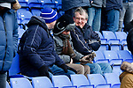 Fans trying to keep warm pre match. Oldham v Portsmouth League 1