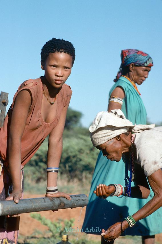 San women at a  water pump in  Tchumkwe, Bushman land, Namibia