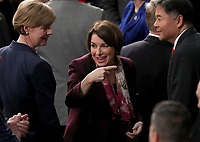 United States Senator Amy Klobuchar (Democrat of Minnesota) speaks with her colleagues prior to United States President Donald J. Trump delivering his second annual State of the Union Address to a joint session of the US Congress in the US Capitol in Washington, DC on Tuesday, February 5, 2019.<br /> Credit: Alex Edelman / CNP / MediaPunchCAP/MPI/RS<br /> ©RS/MPI/Capital Pictures