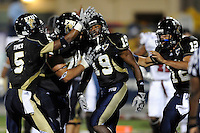 17 October 2009:  FIU running back Kendall Berry (19) celebrates his touchdown with teammates in the second quarter of the Troy 42-33 victory over FIU at FIU Stadium in Miami, Florida.