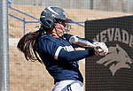 March 7, 2012:   Nevada Wolf Packs Sam Puzey swings against the Sacramento State Hornets during their NCAA softball game played at Christina M. Hixson Softball Park on Wednesday in Reno, Nevada.