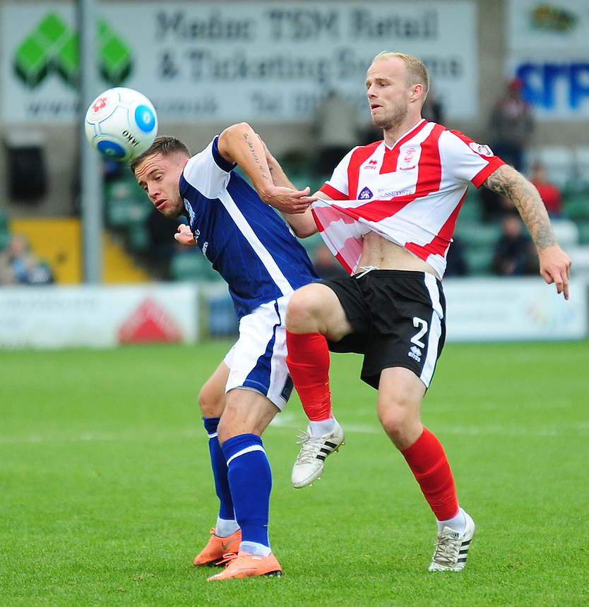 Barrow's Ross Hannah vies for possession with Lincoln City's Bradley Wood<br /> <br /> Photographer Andrew Vaughan/CameraSport<br /> <br /> Vanarama National League - Lincoln City v Barrow - Saturday 17 September 2016 - Sincil Bank - Lincoln<br /> <br /> World Copyright &copy; 2016 CameraSport. All rights reserved. 43 Linden Ave. Countesthorpe. Leicester. England. LE8 5PG - Tel: +44 (0) 116 277 4147 - admin@camerasport.com - www.camerasport.com