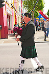 Listowel Army, Agri & Vintage Day : Piper Brendan Hartnett leadin the parade at  the Listowel Army, Agri, & Vintage Day on Sunday last
