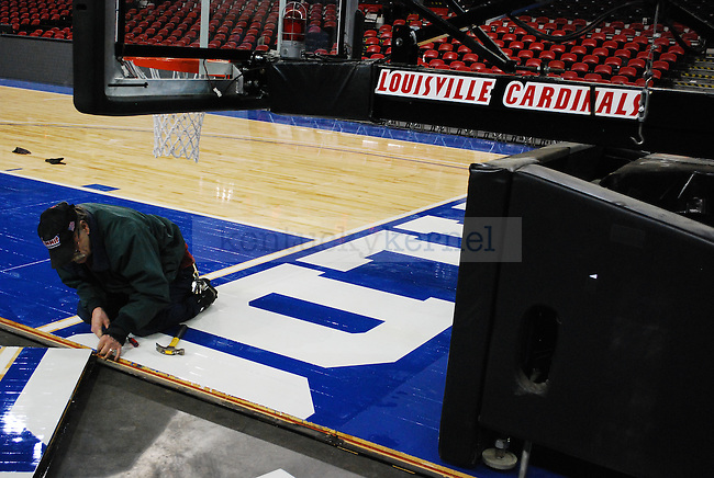 While the new Freedom Hall basketball court displays the University of Kentucky colors, the Louisville Cardinal branding can still be seen. Photo by Ryan Buckler | Staff