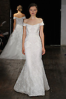 """Model walks runway in an """"Adorable"""" bridal gown from the Alyne by Rita Vinieris Fall 2017 collection on October 7th, 2016 during New York Bridal Fashion Week."""
