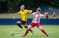 Charlotte Kerr of Watford Ladies goes past Danielle Maloney of Stevenage Ladies  during the pre season friendly match between Stevenage Ladies FC and Watford Ladies at The County Ground, Letchworth Garden City, England on 16 July 2017. Photo by Andy Rowland / PRiME Media Images.