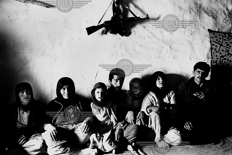 MALUMA, KURDISTAN, IRAQ, JANUARI 1994. A Kurdish family in their home.  Charcoal production is the primary income of the village. one family can produce about 150 kilo per month which brings them $3 per month. deforrestation is a big problem in the area where people have to go further into mined areas to collect wood.©Photo by Frits Meyst/Panos Pictures