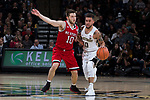 Mitchell Wilbekin (10) of the Wake Forest Demon Deacons dribbles past Braxton Beverly (10) of the North Carolina State Wolfpack during first half action at the LJVM Coliseum on February 17, 2018 in Winston-Salem, North Carolina.  The Wolfpack defeated the Demon Deacons 90-84.  (Brian Westerholt/Sports On Film)
