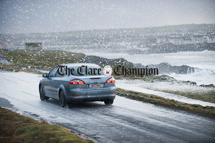 The high seas and stormy conditions near George's Head Kilkee on Wednesday caused the road to be covered in foam, giving a Christmas feel to the area. Photograph by John Kelly.. Photograph by John Kelly.