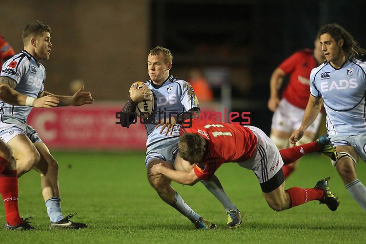Munster wing Luke O'Dara tackles Blues full back Dan Fish..Celtic League.Cardiff Blues v Munster.02.11.12.©Steve Pope