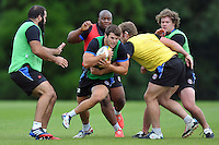 Guy Mercer is tackled in possession. Bath Rugby pre-season training session on July 8, 2014 at Farleigh House in Bath, England. Photo by: Patrick Khachfe/Onside Images