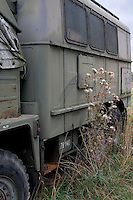 Military truck and thistle at the site of a mock up of a military mess hall in Poland where soup and bread is served. Rawa Mazowiecka Central Poland