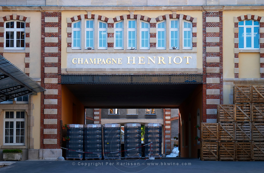The entrance to the winery at Champagne Henriot with empty champagne bottles, Reims, Champagne, Marne, Ardennes, France