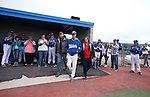 Wildcats' Thomas Kerr takes the field with his parents during Sophomore Day ceremonies at Western Nevada College in Carson City, Nev., on Saturday, April 25, 2015. <br /> Photo by Cathleen Allison