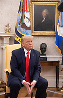 United States President Donald J. Trump listens to a reporter's question as he as he greets Prime Minister Kyriakos Mitsotakis of Greece  in the Oval Office of the White House in Washington, D.C. on Tuesday, January 7, 2020.     <br /> Credit: Tasos Katopodis / Pool via CNP/AdMedia