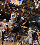 BROOKINGS, SD - FEBRUARY 21:  Deondre Parks #0 from South Dakota State makes an acrobatic shot over Brandon Conley #5 from Oral Roberts in the first half of their game Saturday night at Frost Arena in Brookings. (Photo by Dave Eggen/Inertia)