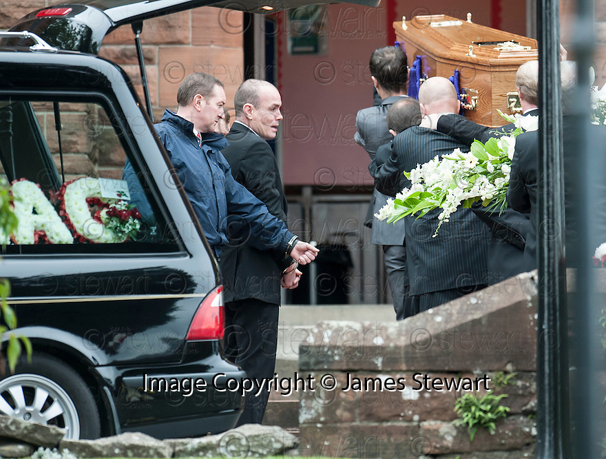 Hugh Haney, still handcuffed to a G4S officer, watches as the coffin of former crime family matriarch Mags Haney is carried into St Mary's RC Church in Stirling.