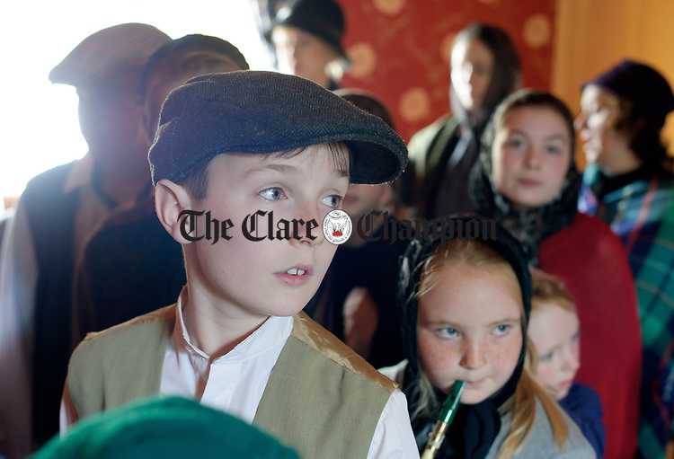 Ciaran Mc Carthy and Maria O Sullivan take a tour of the Parlour during a cultural visit to The Rambling House in Kilmurry Mc Mahon by pupils of Labasheeda National School. Photograph by John Kelly.