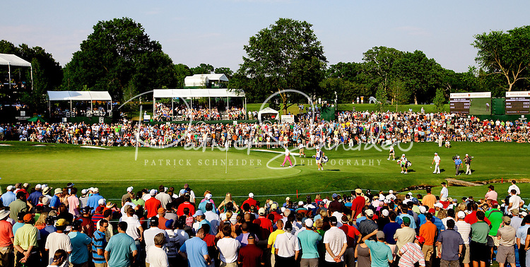 Jonathan Byrd (pink pants) makes his way on to the 18th green at  the Wells Fargo Championship, a PGA championship event held annually in Charlotte NC. The event previously was called The Wachovia Golf Championship. The event is held at the Quail Hollow Club in Charlotte, North Carolina in early May. Since its inception in 2003, the PGA golf championship event has attracted some of the top players on the tour. In 2009, the tournament had a $6.5 million purse with a winner's prize of $1.17 million. The event is often ranked among the PGA Tour's toughest holes. The majority of the charitable proceeds from the tournament benefit Teach for America.