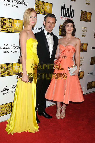 Caitlin FitzGerald, Michael Sheen, Lizzy Caplan<br /> 3rd Annual Critics' Choice Television Awards held at The Beverly Hilton Hotel, Beverly Hills, California, USA.<br /> June 10th, 2013<br /> full length yellow strapless dress silk satin gold dress orange black tuxedo   <br /> CAP/ADM/BP<br /> &copy;Byron Purvis/AdMedia/Capital Pictures